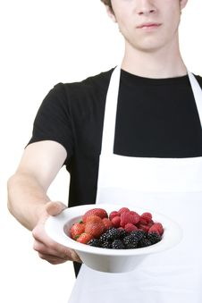 Free Man Holding A Single Serving Of Berries Royalty Free Stock Photography - 9502677
