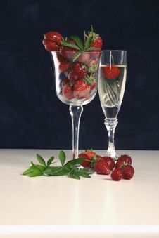 Strawberry And One Glass Full Of The Champagne Stock Photos