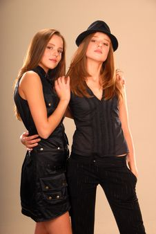 Free Twin Girls In Black Clothes Hugging Each Other Royalty Free Stock Photography - 9508577