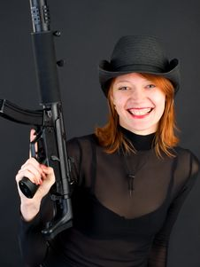 Young Woman Holding The Gun Royalty Free Stock Image