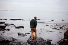 Free Man Standing On Rocks At Seaside Stock Photography - 95031492