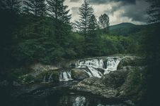 Free Waterfall Cascading Through A Forest Stock Photography - 95031852