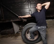 Free Man Posing By A Truck Stock Image - 9512061