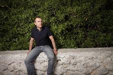 Free Man Sitting On A Ledge Stock Photos - 9512263