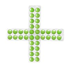 Cross From Packs Of Green Tablets Stock Photos