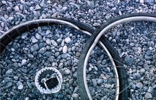 Free Bent Wheel On The Gray Gravel Royalty Free Stock Photography - 9513057