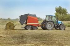 Free Tractor Plowing Field Stock Photography - 9514842