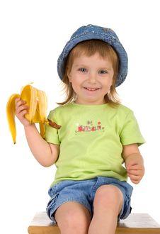 Free Little Girl Eats A Banana Stock Images - 9519464