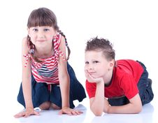 Free Cute Blue-eyed Boy And Girl Posing In The Studio Royalty Free Stock Images - 9519519
