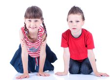 Free Cute Blue-eyed Boy And Girl Posing In The Studio Stock Images - 9519524