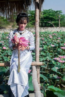 Free Woman Holding Lotus Flowers Stock Photography - 95108642