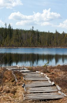 Old Wooden Pier To Lake Stock Photo
