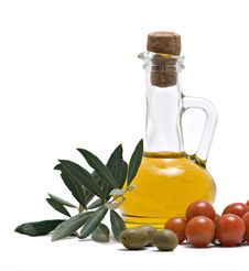 Bottle Of Olive Oi, Tomatoes, And Olive Fruits Stock Photos