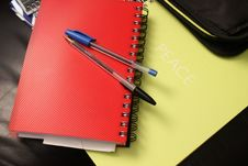 Free Blue And Black Ball Point Pens On Red Hand Book Royalty Free Stock Photo - 95220525