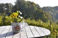 Free Flowers In Teapot On Table Royalty Free Stock Photos - 95271828