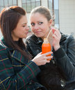 Free Two Girls Drink Juice Royalty Free Stock Photos - 9535028