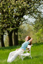 Free Woman Relax Under Blossom Tree In Summer Stock Image - 9536151