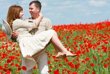 Free Couple On Red Poppies Field Stock Photo - 9530520