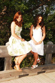 Free Two Sisters Sitting On Bridge. Royalty Free Stock Photo - 9531525