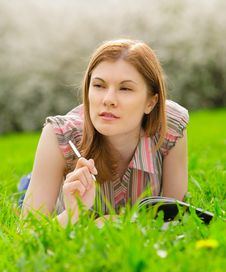 Free Pretty Student Studying Outdoors Stock Photo - 9536720