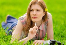 Pretty Girl Studying Outdoors Royalty Free Stock Image