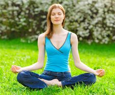 Beautiful Woman Meditating Outdoors Royalty Free Stock Images
