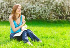 Free Pretty Student Studying Outdoors Stock Image - 9536961