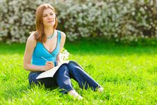 Free Pretty Student Studying Outdoors Stock Image - 9536971