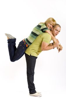 Free Young Man Holding His Girlfriend In The Air Royalty Free Stock Image - 9538396