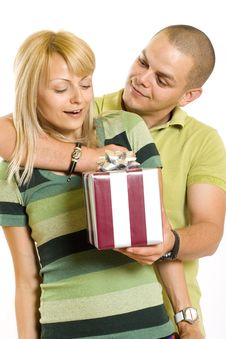 Free Man Giving A Present Tot His Girlfriend Royalty Free Stock Image - 9538616