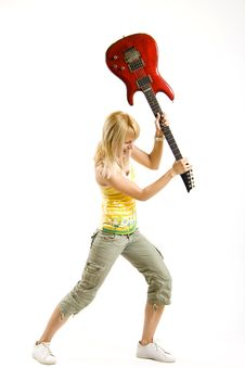 Woman Guitarist Breaking Her Guitar Stock Image