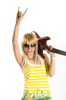 Free Attractive Woman Guitarist Making A Rock Sign Stock Photo - 9538850