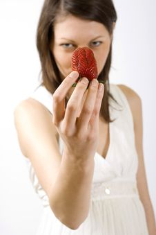Free Woman Holding A Strawberry Royalty Free Stock Photo - 9539055