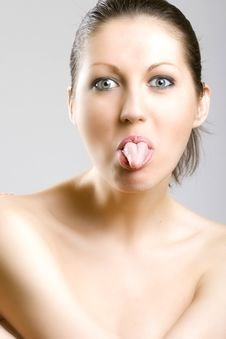 Free Closeup Of A Woman S Face - Tongue Out Royalty Free Stock Photography - 9539377