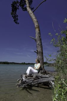 Blonde Female Enjoying The Nature At A Lake Stock Image