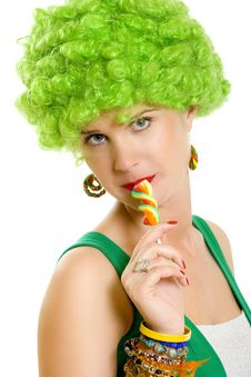 Attractive Woman With Green Wig Sucking On A Lolly Stock Photography