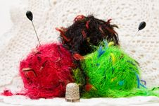 Free Colorful Knitting Yarns Over White Lace Royalty Free Stock Photo - 9542355