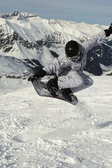 Snowboarder Flying Over The Slope Royalty Free Stock Photos