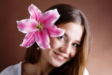 Free Young Woman Posing With A Pink Lily Stock Photography - 9543592