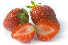 Two Ripe Strawberries And Two Segments Royalty Free Stock Image