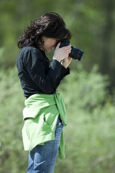 Female Photographer In A Forest. Royalty Free Stock Images