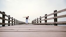 Free Girl Balances Along Empty Pier Stock Photo - 9548190