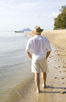 Man Strolling On The Beach Stock Photography