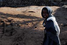 Free Smiling Child In Black Dress Shirt Walking On Brown Sand During Daytime Stock Image - 95409531