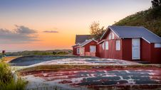 Free Red Houses In Field At Sunset Stock Photo - 95409590