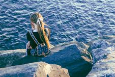 Free Young Woman Sitting By The Sea Stock Image - 95409661