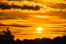 Free Sunset In Orange Skies Over Tree Tops Royalty Free Stock Image - 95476836