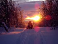 Free Snowmobile On Track At Sunset Royalty Free Stock Images - 95476869