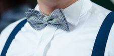 Free Man In White Dress Shirt Blue Suspenders And Gray Polka Dotted Bowtie Stock Images - 95476874