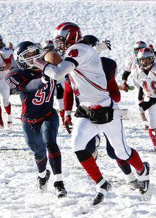 Free Football Players On Snowy Field Royalty Free Stock Photography - 95476947